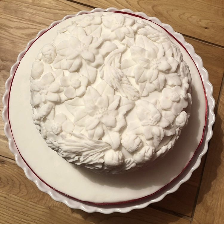 All-white bas relief cake